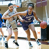 Goshen College guard Graysen Cockerham (4) dribbles the ball down court against Holy Cross College guard Arielle Thatcher (3) during Wednesday's game at Holy Cross College in South Bend.