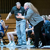 Goshen College head coach Stephanie Miller reacts after a play during Wednesday's game at Holy Cross College in South Bend.