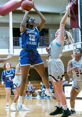 Goshen College center Keyaira Murff (33) shoots a basket against Holy Cross College forward Allison Hano (21) during Wednesday's game at Holy Cross College in South Bend.