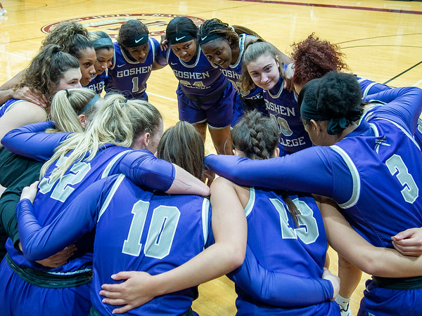 Goshen College women's basketball team huddles before Wednesday's game at Holy Cross College in South Bend.