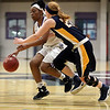 JAY YOUNG | THE GOSHEN NEWS<br /> Goshen College senior Lynnia Noel, left, tries to get past Spring Arbor senior Kylie Townsley during their game Wednesday evening in Goshen.
