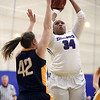 JAY YOUNG | THE GOSHEN NEWS<br /> Goshen College senior Gabby Williams (34) concentrates on her shot while Spring Arbor sophomore Ashley Parker (42) applies defensive pressure during their game Wednesday evening in Goshen.