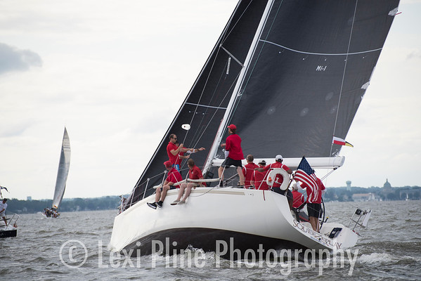 "The IMX-40 ""SqueeZeplay"" gets ready for the evening start of the Governor's Cup Regatta last Friday."