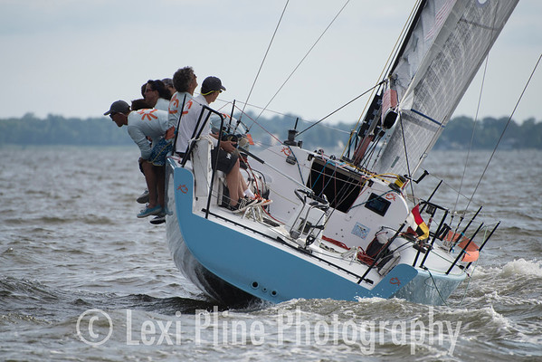 The crew of Blofish, an 1D35-T, hike hard off the line following the evening start of the Governor's Cup Regatta last Friday.