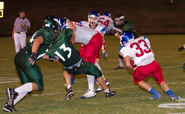 Unlucky 13 gets de-cleated as Cameron Bailey follows Cody Kinney's thunder block.  Iowa Park Hawks (09-19-2008)