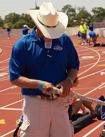 Coach Sides multitasks at the State  Meet
