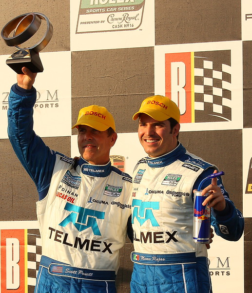 Memo Rojas and Scott Pruett Celebrate on Podium Barber Motorsports Park
