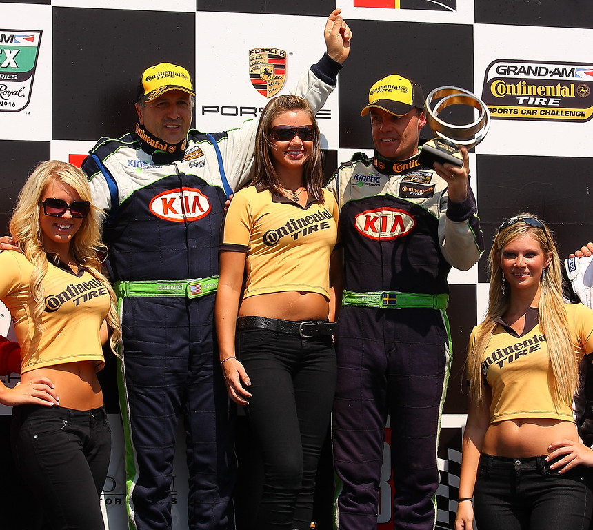 KIA Kinetic Celebration with Continental Tire Girls on Podium Barber