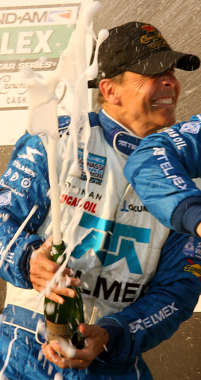 Scott Pruett Lets the Champagne Fly after Barber Victory
