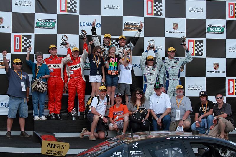 Rolex and Continental Tire Grand-Am Fans on Podium Porsche 250 GT Winners Barber