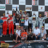 Rolex and Continental Tire Grand-Am Fans on Podium Porsche 250 GT Winners Barber