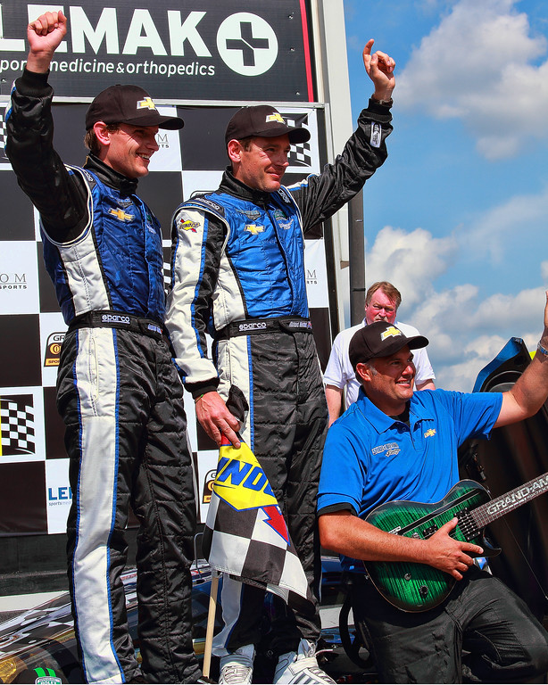 Grand-Am Rolex SPorts Car Series Spirit of Daytona Team celebrates winning Porsche 250