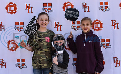 (From left) Emory Morris (11), Hudson Morris (4) and Riley Morris (9) smile for a photo with baseball props at Brook Hill Grand Opening Ceremony for Herrington Field on Saturday, February 8. (Jessica T. Payne/Tyler Morning Telegraph)