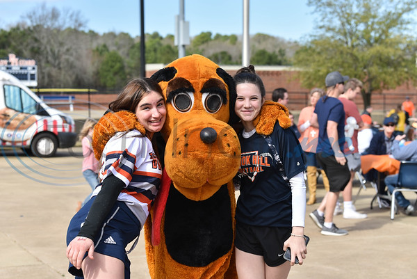 Brook Hill high school students Miriam Bandaji (left) and Dominika Ducal (right) smile for a photo with the Guard Dog mascot at the Grand Opening Ceremony for the schools Herrington Baseball Field on Saturday, February 8. (Jessica T. Payne/Tyler Morning Telegraph)