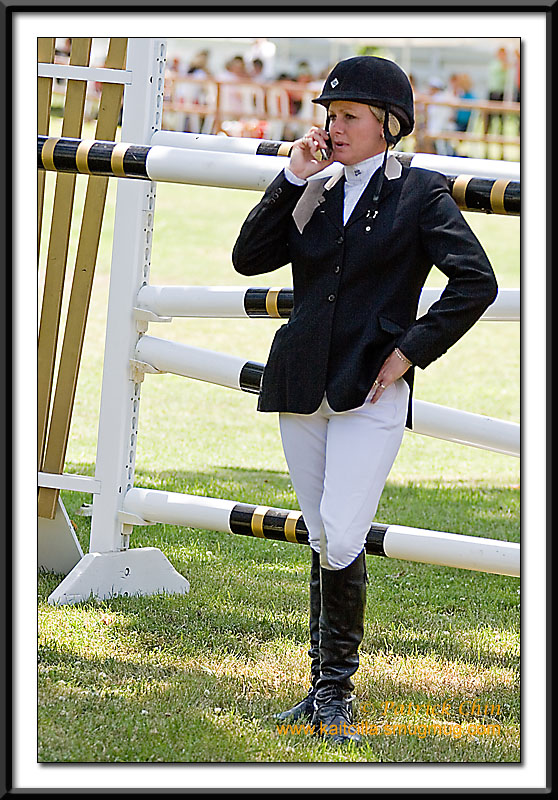 A jockey's on the phone before the pro event.