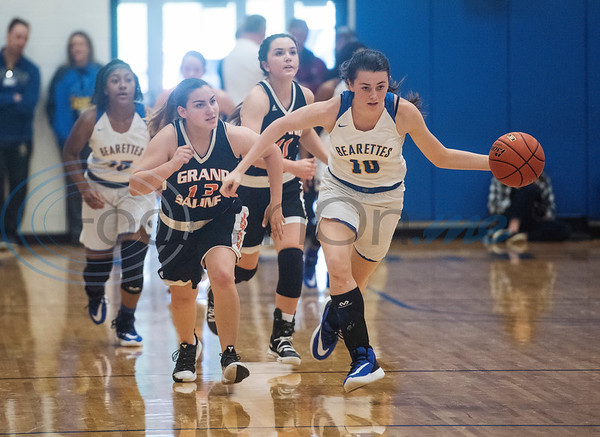 Brownsboro's Paris Miller (10) moves the ball past with Grand Saline's Tatum Sanchez (13) behind her during the Great East Texas Shoot Out held at Brownsboro High School on Thursday, Dec. 12, 2019.  (Sarah A. Miller/Tyler Morning Telegraph)