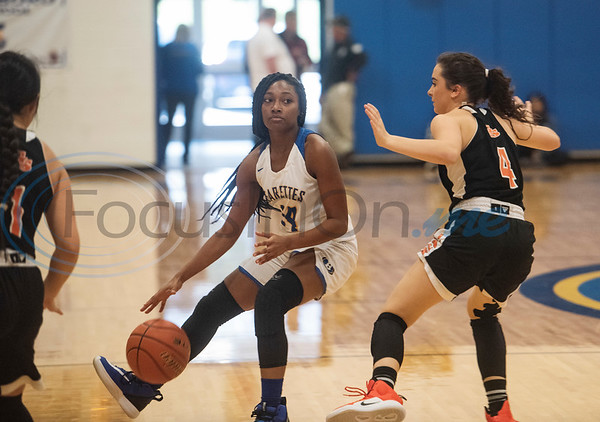 Brownsboro's Shakayla Warren (10) moves the ball past Grand Saline's Maddy Bolin (4) at her side during the Great East Texas Shoot Out held at Brownsboro High School on Thursday, Dec. 12, 2019.  (Sarah A. Miller/Tyler Morning Telegraph)