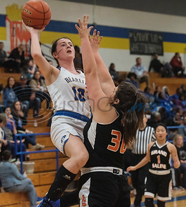 Brownsboro's Paris Miller (10) moves the ball past Grand Saline's Morgan Stilwell (30) during the Great East Texas Shoot Out held at Brownsboro High School on Thursday, Dec. 12, 2019.  (Sarah A. Miller/Tyler Morning Telegraph)