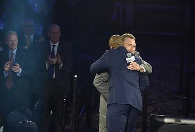 Tom Hamilton hugs host Eddie George upon his arrival on stage.  KRISTIN BAUER   CHRONICLE