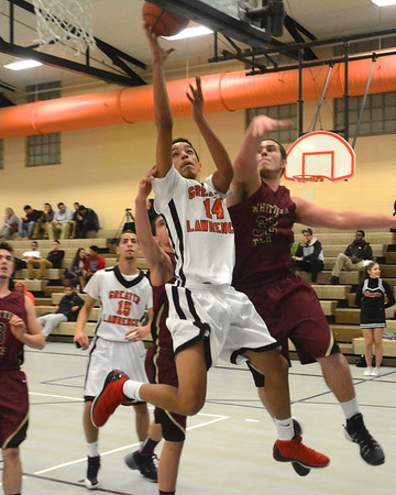 RYAN HUTTON/ Staff photo<br /> Greater Lawrence Tech's Frankely Estrella (14) fires up a shot over Whittier Tech's Sydney Taylor (33) during Thursday night's game. Greater Lawrence won 57-29.