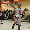 RYAN HUTTON/ Staff photo<br /> Greater Lawrence Tech's Stanley Martinez (13) puts up an uncontested layup against Whittier Tech during Thursday night's game. Greater Lawrence won 57-29.