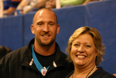 Assistant to the President and Office Manager of the Greensboro Revolution Julie Malcuit with NFL star wide receiver Ricky Proehl team up to promote Proehl's Football Camp.