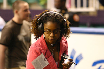 Greensboro Revolution's Director of Game Operations Dee Mittman directs half-time activities.