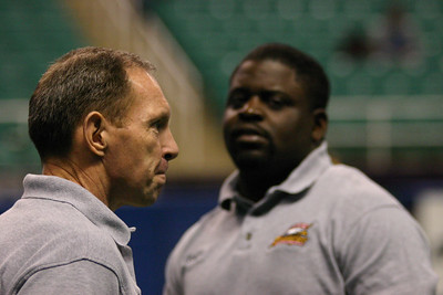 Greensboro Revolutions Wide Receiver Coach Dale Glossenger and Defensive Assistant Malachi King meet before game time.
