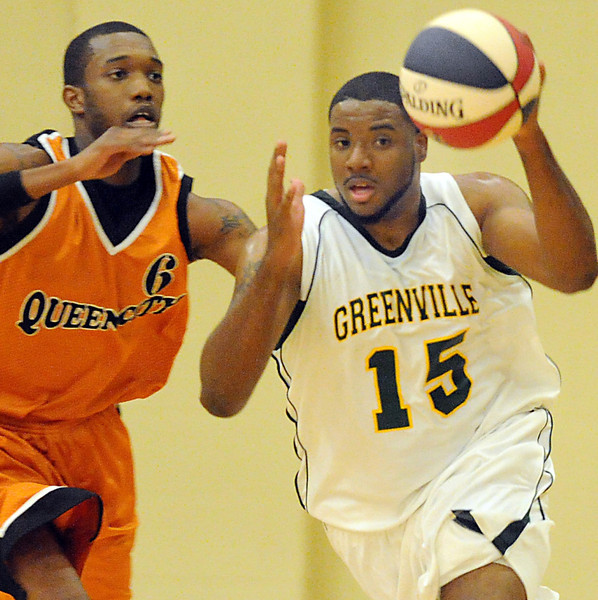 The Greenville Galaxy played host to the Queen City Express in an ABA basketball game at the First Baptist Church on Cleveland St. in Greenville, SC.<br /> GWINN DAVIS PHOTOS<br /> gwinndavisphotos.com (website)<br /> (864) 915-0411 (cell)<br /> gwinndavis@gmail.com  (e-mail) <br /> Gwinn Davis (FaceBook)