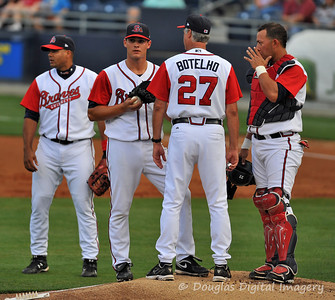 GBraves pitching coach Botelho talks to Ryne Reynoso while JC Boscan and Barbaro Canizares listen in.