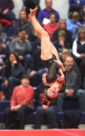 Tayla Thome of Buckeye upside down during her Floor Routine at sectionals at West Geauga. BRUCE BISHOP / GAZETTE