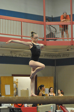 Kelsey Matthews of Plainville competes on tne balance beam for the west.