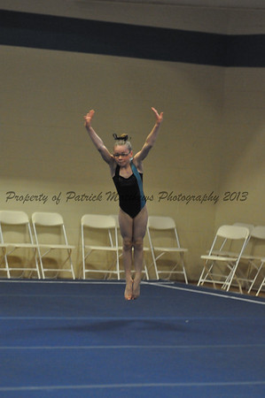 Kelsey Matthews of Plainville competes on the floor exercise for the west.
