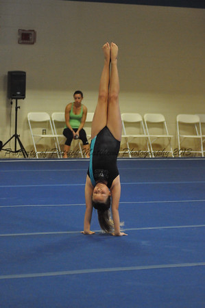 Alexa Caron Southington competes on the floor excerise for the West.