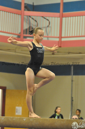 Ellie Farrell of Chesire competes on the balance beam for the West.
