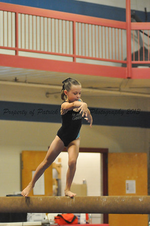 Lauren Brennan of Southington competes on the balance beam bars for the West.