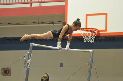 Cloe Bauman of Southington competes on the uneven parallel bars for the West.
