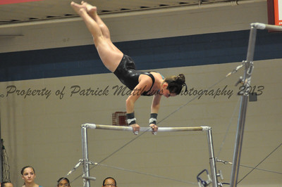 Maddy Chamis of Southington competes on the uneven parallel bars for the West.