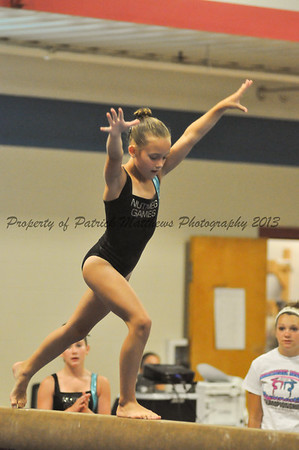 Cloe Bauman of Southington competes on the balance beam for the West.