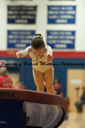 Emma Shalagan competes on vault  during the YMCA State competition held at Plainville HIgh School on April 4th and 5th
