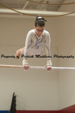 Natalie Diaz competes on bars  during the YMCA State competition held at Plainville HIgh School on April 4th and 5th
