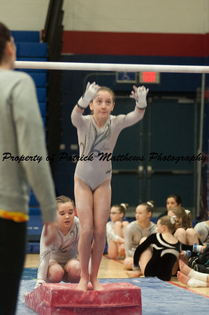 Emma Shalagan competes on bars during the YMCA State competition held at Plainville HIgh School on April 4th and 5th