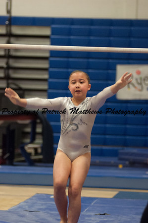Natalie DeMatteo competes on bars  during the YMCA State competition held at Plainville HIgh School on April 4th and 5th