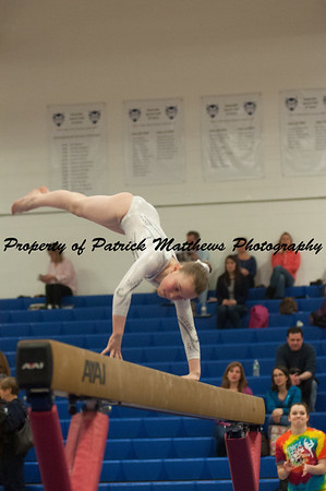Ellie Farrell competes on beam during the YMCA State competition held at Plainville HIgh School on April 4th and 5th