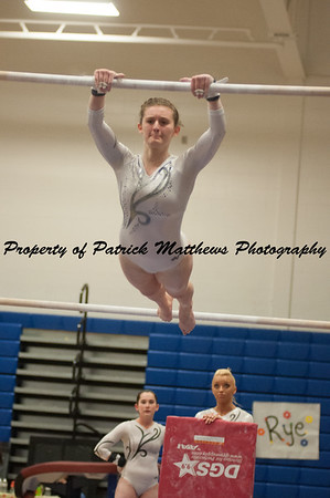 Kylie Sarantides competes on bars  during the YMCA State competition held at Plainville HIgh School on April 4th and 5th