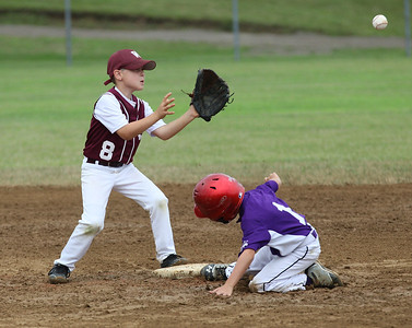 July 20 2013 ___ Ryan Walsh of Keystone is safe at 2nd before the ball reaches Dylan Evans of Wellington at Wellington Community Park in Wellington. photo by Ray Riedel