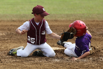 July 20 2013 ___ Keystone's Ryan Walsh is safe at 2nd before Duke's Jonathan Brasee can make the tag at Wellington Community Park in Wellington. photo by Ray Riedel