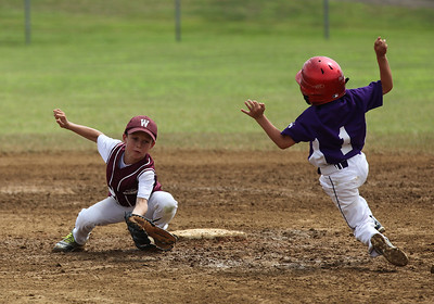 July 20 2013 ___ Keystone's Ryan Walsh rushes to 2nd before Duke's Jonathan Brasee can make the tag at Wellington Community Park in Wellington. photo by Ray Riedel