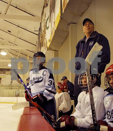 2007-10-08 StMary'sHOCKEY 262x #34 Anthony Sgraglia, Coach Lazar, #77 Tim Baxter.