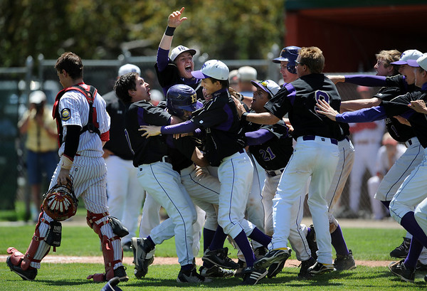 Holy Family celebrate after defeating Eaton High in the 3A Colorado State Baseball Championship game at Butch Butler Field in Greeley, Colo. on Saturday 05/29/10.  The game was called after the 5th inning when Holy Family went up 11-1 to clinch the victory.  (SPECIAL TO THE POST/ MATT MCCLAIN)
